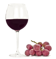 Photo of glass of red wine with bunch of grapes