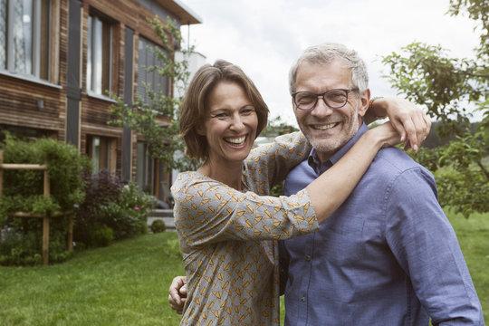 Portrait of happy mature couple in garden