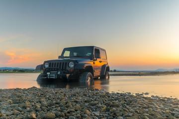 4x4 car against the sunset.