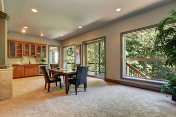 Open floor plan dining room with view of kitchen cabinetry