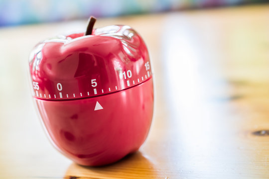 5 Minutes - Kitchen Egg Timer In Apple Shape On Wooden Table