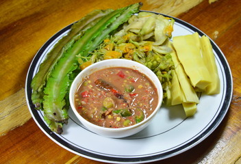 spicy shrimp paste sauce eat with mixed boiled vegetable on plate