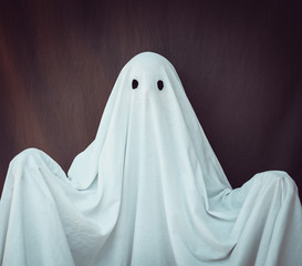White Ghost on a gray background. Halloween holiday