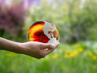 Large, luminous ball on a female hand. The concept of the death of the planet, global disaster, environmental destruction