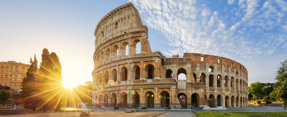 Poster Historical buildings Colosseum in Rome and morning sun, Italy