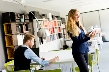 Woman with tablet in office