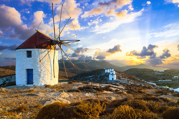 beautiful sunset over windmills. Amorgos island, Greece