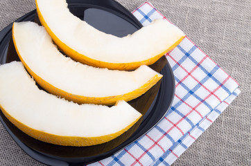 Healthy and useful dessert of sweet yellow melon slices