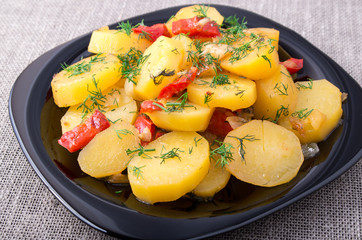 Close Up view on stew of potatoes with bell pepper