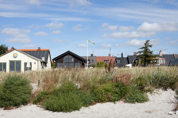 beautiful beach with apartment houses in the south of sweden