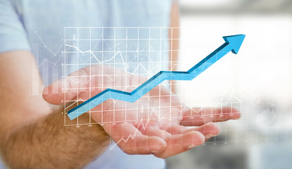 Businessman holding digital charts bars and blue arrow