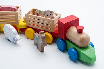 Wooden toy train with colorful blocks isolated over white