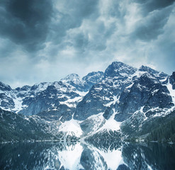 Beautiful landscape of majestic mountains and a clear lake
