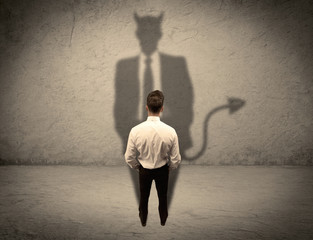 Salesman facing his own devil shadow