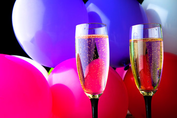 Two glasses of champagne and balloons on party