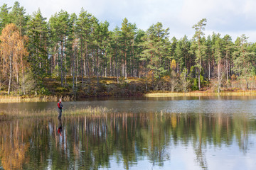 Man fly fishing in a lake in the forest