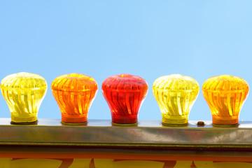 Bright colourful glass light bulbs on Big Wheel fun fair ride