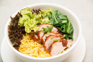 Peking Duck noodle soup in a white bowl