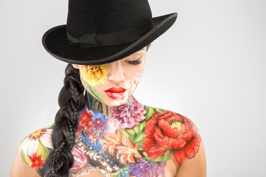 Body art model at gray background