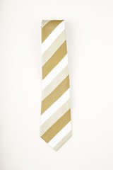 Modern striped tie on plain background
