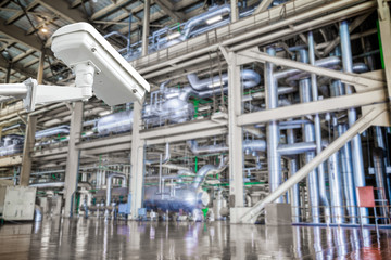 CCTV camera operating inside industrial factory