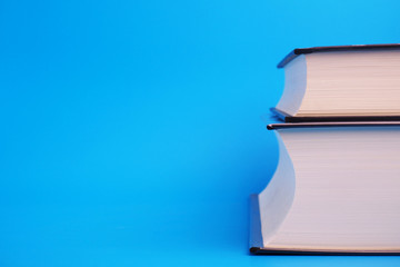 Pile of books on blue background.