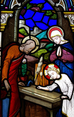 Jesus working as a carpenter (stained glass)