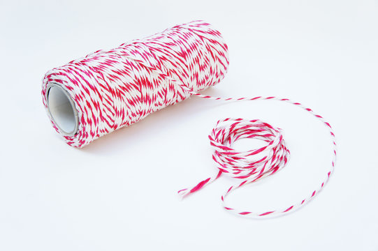 Red and white rope tied tie multipurpose items seized or sticky material.