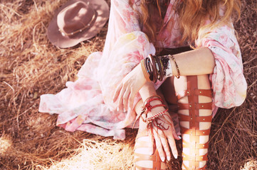 Female hands with boho bracelets, outdoor fashion portrait in a forest