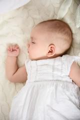 Adorable baby girl taking nap