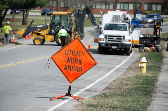 utility work and warning sign on the street