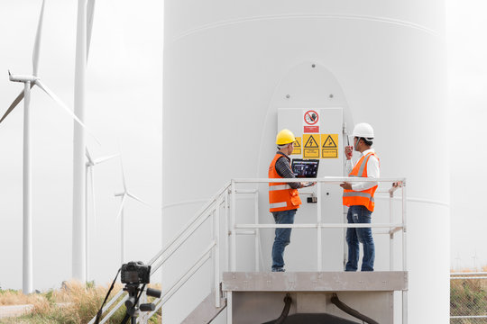 Engineers and technician working in wind turbine station