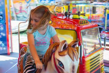 Little girl in carousel