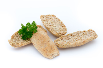 Dry flat bread crisps with herbs on a white background.
