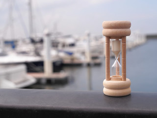 The hourglass in yacht harbor