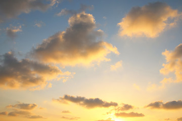Image of gold sunset sky with clouds