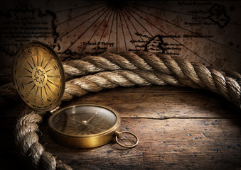 Wall Mural - old compass and rope on vintage map