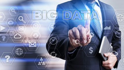 """Businessman is pressing on the virtual screen and selecting """"Big data""""."""