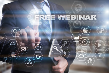 "Businessman is pressing on the virtual screen and selecting ""Free webinar""."