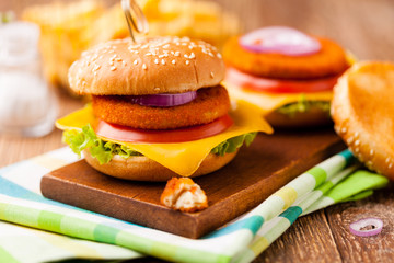 Delicious fish burgerserved with fresh french fries.