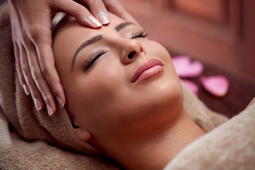 woman enjoy in face massage