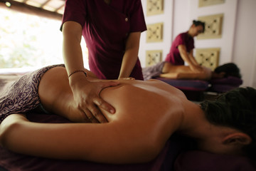 Couple receiving massage at health spa