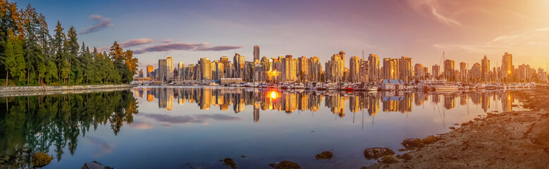 Beautiful Vancouver skyline and harbor area in golden evening light, Canada