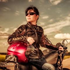 Fototapete - Biker girl sitting on motorcycle