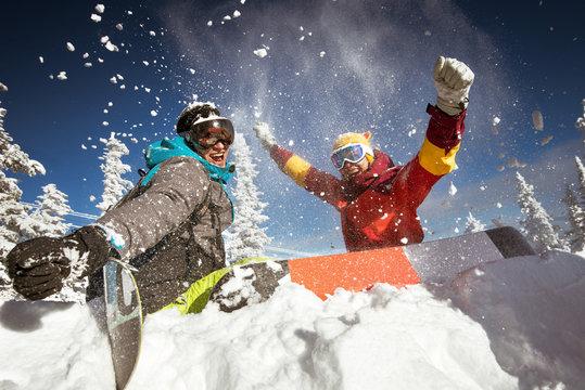 Couple of snowboarders having fun