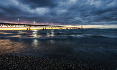 Storm Clouds Over Mackinaw. Storm clouds envelop the sunset over the Mackinaw Bridge in Michigan.