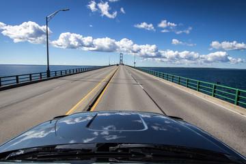 Driving across the Mackinac Bridge in Michigan.  It is the largest suspension bridge in the Western Hemisphere. The bridge is part of Interstate 75.