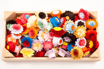 Small, colorful paper flowers made with quilling technique - details
