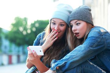 friends watching videos