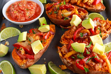 hot baked sweet potato stuffed with yellow, red pepper, chicken, cheese, herbs and salsa. selected focus